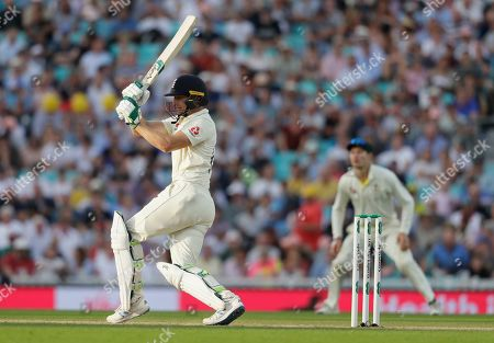 England's Jos Buttler plays a shot off the bowling of Australia's Peter Siddle during the third day of the fifth Ashes test match between England and Australia at the Oval cricket ground in London