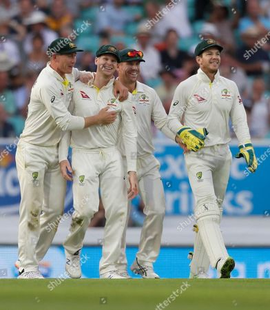 Stock Image of Australia's Steve Smith, second left, celebrates catching England's Chris Woakes during the third day of the fifth Ashes test match between England and Australia at the Oval cricket ground in London