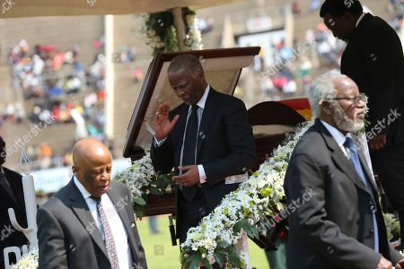 Stock Photo of Former South African President Thabo Mbeki,center, pays his respects to former Zimbabwean leader, Robert Mugabe at the National Sports stadium during a funeral procession in Harare, Saturday, Sept, 14, 2019. African heads of state and envoys gathered to attend a state funeral for Zimbabwe's founding president, Robert Mugabe, whose burial has been delayed for at least a month until a special mausoleum can be built for his remains