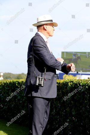 Trainer JOHN GOSDEN looks out on to the track as LOGICIAN wins The Group 1 William Hill St Leger Stakes over 1m 6f (£700,000)  during the fourth and final day of the St Leger Festival at Doncaster Racecourse, Doncaster