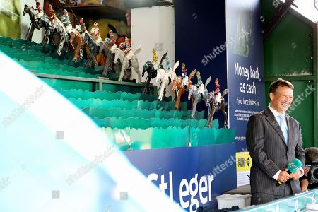 Racing Presenter and Commentator Richard Hoiles calls the horses home on the William Hill St Leger Game during the fourth and final day of the St Leger Festival at Doncaster Racecourse, Doncaster