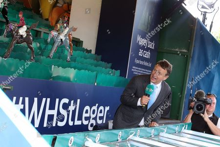 Racing Presenter and Commentator Richard Hoiles calls the horses home on the William Hill St Legerl Game  during the fourth and final day of the St Leger Festival at Doncaster Racecourse, Doncaster