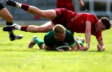 Connacht vs Munster. Stephen Kerins scores a try despite Charlie O'Doherty of Munster