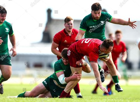 Connacht vs Munster. Pa Ryan of Munster is tackled by Peter Sullivan of Connacht