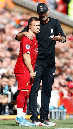 Stock Image of Liverpool's manager Jurgen Klopp, right, talks to Liverpool's Xherdan Shaqiri during the English Premier League soccer match between Liverpool and Newcastle at Anfield stadium in Liverpool, England