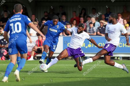AFC Wimbledon attacker Michael Folivi (17) tries to shoot but Shrewsbury Town defender Aaron Pierre (2) tackles during the EFL Sky Bet League 1 match between AFC Wimbledon and Shrewsbury Town at the Cherry Red Records Stadium, Kingston