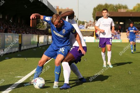 AFC Wimbledon attacker Marcus Forss (15) battles for possession with Shrewsbury Town defender Aaron Pierre (2) during the EFL Sky Bet League 1 match between AFC Wimbledon and Shrewsbury Town at the Cherry Red Records Stadium, Kingston