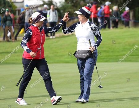 Morgan Pressel, right, and Marina Alex of the U.S celebrate after winning the 12th hole during their Foursomes match against Europe in the Solheim Cup at Gleneagles, Auchterarder, Scotland