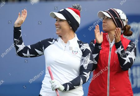Morgan Pressel, left, and Marina Alex,of the U.S wave to the crowd during their Foursomes match against Europe in the Solheim Cup at Gleneagles, Auchterarder, Scotland