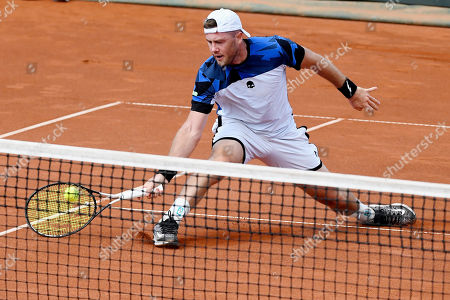 Stock Image of Illya Marchenko of Ukraine plays against Marton Fucsovics of Hungary in rubber 2 of tennis Davis Cup Group I, Europe/Africa 1st round match Hungary vs. Ukraine in Budapest, Hungary, 14 September 2019.