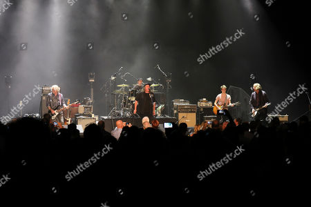 Bill Berry, Peter Buck, Mike Mills, Michael Stipe, Kevn Kinney. Bill Berry, Peter Buck, Mike Mills, Michael Stipe and Kevn Kinney of Drivin N Cryin with R.E.M. performs as the opener for Drive-By Truckers at the Fox Theatre during the Benefit for the Fox Theatre Institute, in Atlanta
