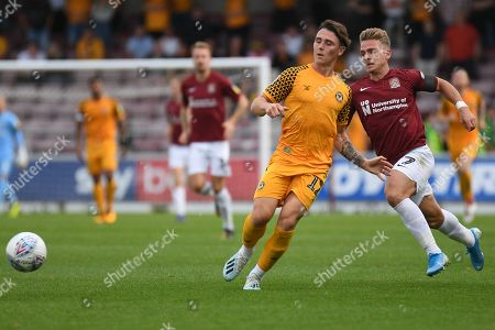 Newport County defender (on loan from Millwall) Danny McNamara (12) clears under pressure from Northampton Town defender midfielder Sam Hoskins (7) during the EFL Sky Bet League 2 match between Northampton Town and Newport County at the PTS Academy Stadium, Northampton