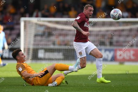 Northampton Town midfielder Nicky Adams (10) skips the challenge of Newport County defender (on loan from Millwall) Danny McNamara (12) during the EFL Sky Bet League 2 match between Northampton Town and Newport County at the PTS Academy Stadium, Northampton