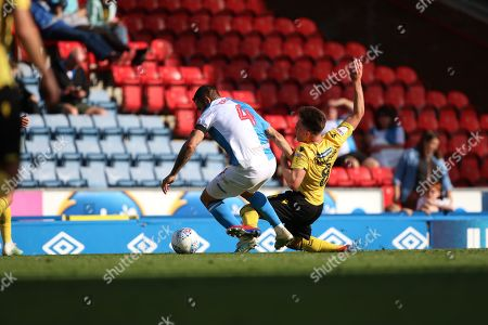 Blackburn Rovers Bradley Johnson takes Millwall's Ben Thompson  during the EFL Sky Bet Championship match between Blackburn Rovers and Millwall at Ewood Park, Blackburn