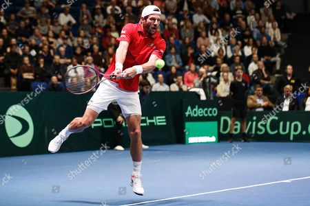 Juergen Melzer of Austria in action against Henri Kontinen and Emil Ruusuvuori of Finland during their doubles match for the Davis Cup tie between Finland and Austria, in Helsinki, Finland, 14 Septmber 2019.
