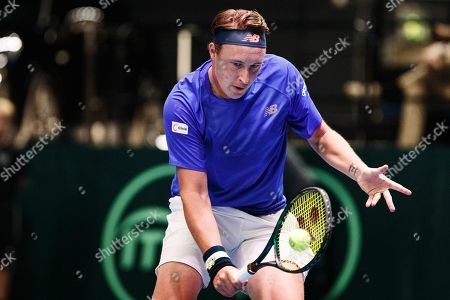 Stock Photo of Henri Kontinen of Finland in action against Juergen Melzer and Oliver Marach of Austria during their doubles match for the Davis Cup tie between Finland and Austria, in Helsinki, Finland, 14 Septmber 2019.