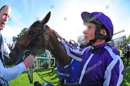 LEOPARDSTOWN. QIPCO Irish Champion Stakes (Group 1). MAGICAL and Ryan Moore after their win for trainer Aidan O'Brien.