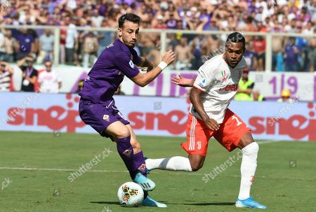 Fiorentina's Gaetano Castrovilli (L) in action against Juventus' Alex Sandro (R) during the Italian Serie A soccer match between ACF Fiorentina and Juventus FC at the Artemio Franchi stadium in Florence, Italy, 14 September 2019.
