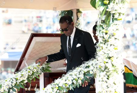 The President of Equatorial Guinea Teodoro Obiang Nguema Mbasogo pays last respect at the coffin with the body of the former Zimbabwean President Robert Mugabe during a funeral ceremony at the National Sports Stadium, in Harare, Zimbabwe, 14 September 2019. Invited heads of states and former Presidents attended the ceremony. Mugabe passed away on 06 September aged 95 in Singapore, where he had been receiving treatment since April this year. Mugabe led the country post-independence from 1980 to 2017 when he was ousted.
