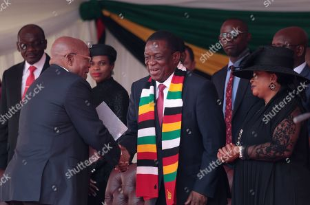 Zimbabwean President Emmerson Mnangagwa (3-R) greets former South African president Jacob Zuma (L) as he arrives for the state funeral of former Zimbabwean President Robert Mugabe, at the National Sports Stadium,in Harare, Zimbabwe, 14 September 2019. Invited heads of states and former Presidents attended the ceremony. Mugabe passed away on 06 September aged 95 in Singapore, where he had been receiving treatment since April this year. Mugabe led the country post-independence from 1980 to 2017 when he was ousted.