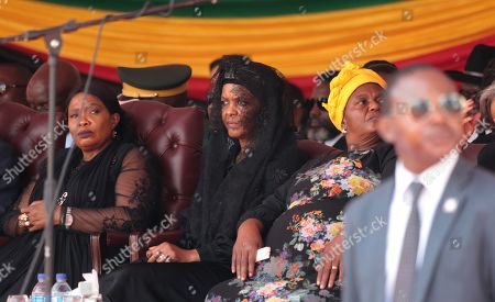 Former First Lady Grace Mugabe (C) follows the proceedings at her late husband and  former Zimbabwean President Robert Mugabe 's state funeral service at the National Sports Stadium, in Harare, Zimbabwe, 14 September 2019. Invited heads of state and former Presidents attend the ceremony. Mugabe passed away on 06 September aged 95 in Singapore where he had been receiving treatment since April this year. Mugabe led the country post-independence from 1980 to 2017 when he was ousted in a military coup.