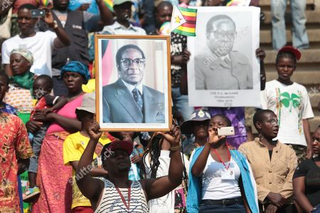 People attend former Zimbabwean President Robert Mugabe's state funeral service at the National Sports Stadium, in Harare, Zimbabwe, 14 September 2019. Invited heads of state and former Presidents attended the ceremony. Mugabe passed away on 06 September aged 95 in Singapore where he had been receiving treatment since April this year. Mugabe led the country post-independence from 1980 to 2017 when he was ousted in a military coup.