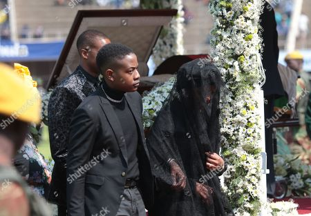Former First Lady Grace Mugabe (R) is led out by her son Chatunga during former Zimbabwean President Robert Mugabe's state funeral service at the National Sports Stadium, in Harare, Zimbabwe, 14 September 2019. Invited heads of state and former Presidents attend the ceremony. Mugabe passed away on 06 September aged 95 in Singapore where he had been receiving treatment since April this year. Mugabe led the country post-independence from 1980 to 2017 when he was ousted in a military coup.
