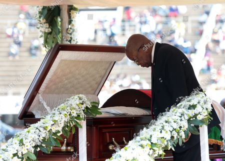 Former South African President Jacob Zuma pays last respect at the coffin with the body of the former Zimbabwean President Robert Mugabe during a funeral ceremony at the National Sports Stadium, in Harare, Zimbabwe, 14 September 2019. Invited heads of states and former Presidents attended the ceremony. Mugabe passed away on 06 September aged 95 in Singapore, where he had been receiving treatment since April this year. Mugabe led the country post-independence from 1980 to 2017 when he was ousted.