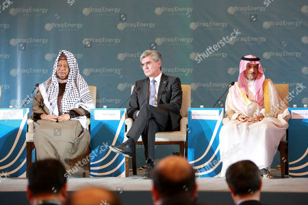 Joe Kaeser, President and Chief Executive Officer of Siemens, speaks during the 5th Iraq Energy Forum 2019 at al-Rashid hotel in central Baghdad, Iraq, 14 September 2019.  The 5th Iraq Energy Forum (IEF 2019), taking place in Baghdad from 14 until 17 September 2019 under the title 'Economic Cooperation for Middle East Peace and Prosperity', brings together the Iraqi Government in collaboration with relevant ministries, policy makers, government officials, industry leaders, experts and the investor community. At right sits Mohammad Abunayyan, Chairman of Saudi Arabian Abunayyan Holding and ACWA Power International, at left Mohammed Sanusi Barkindo, Nigerian politician and Secretary General of OPEC.