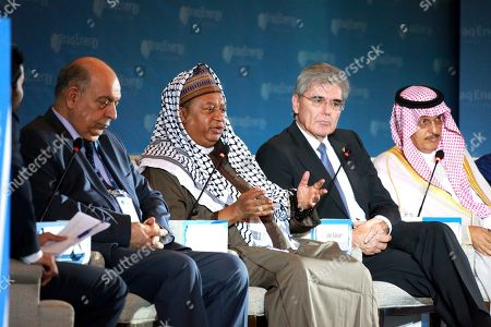 Mohammad Sanusi Barkindo, the OPEC Secretary General (2-L) speaks during the 5th Iraq Energy Forum 2019 at al-Rashid hotel in central Baghdad, Iraq, 14 September 2019.  The 5th Iraq Energy Forum (IEF 2019), taking place in Baghdad from 14 until 17 September 2019 under the title 'Economic Cooperation for Middle East Peace and Prosperity', brings together the Iraqi Government in collaboration with relevant ministries, policy makers, government officials, industry leaders, experts and the investor community. At right sits Mohammad Abunayyan, Chairman of Saudi Arabian Abunayyan Holding and ACWA Power International, 2nd right is Joe Kaeser, President and Chief Executive Officer of Siemens.