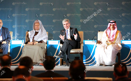 Joe Kaeser, President and Chief Executive Officer of Siemens (2-R), speaks during the 5th Iraq Energy Forum 2019 at al-Rashid hotel in central Baghdad, Iraq, 14 September 2019.  The 5th Iraq Energy Forum (IEF 2019), taking place in Baghdad from 14 until 17 September 2019 under the title 'Economic Cooperation for Middle East Peace and Prosperity', brings together the Iraqi Government in collaboration with relevant ministries, policy makers, government officials, industry leaders, experts and the investor community. At right sits Mohammad Abunayyan, Chairman of Saudi Arabian Abunayyan Holding and ACWA Power International, at left Mohammed Sanusi Barkindo, Nigerian politician and Secretary General of OPEC.