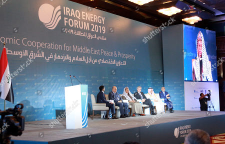 Ziad Daoud, Middle East chief economist pf Bloomberg (L), Thamir Al-Ghadhban, Iraqi deputy prime minister for energy affairs (2-L), Mohammad Sanusi Barkindo, OPEC Secretary General (3-L), Joe Kaeser, President and Chief Executive Officer of Siemens (3-R), Mohammed Abunayyan Chairman of the Board Acwa Power (2-R), Hussain Al-nowais chairman of AMEA power (R) take part in the 5th Iraq Energy Forum at al-Rashid hotel in central Baghdad, Iraq, 14 September 2019.  The 5th Iraq Energy Forum (IEF 2019), taking place in Baghdad from 14 until 17 September 2019 under the title 'Economic Cooperation for Middle East Peace and Prosperity', brings together the Iraqi Government in collaboration with relevant ministries, policy makers, government officials, industry leaders, experts and the investor community.
