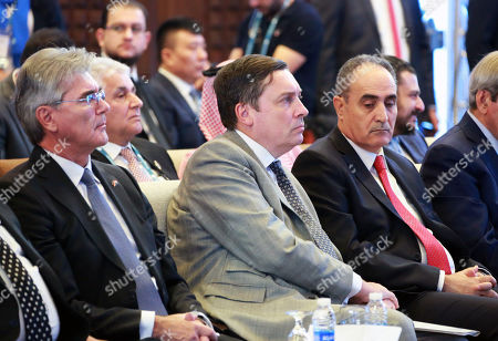 British Ambassador to Iraq Jon Wilks (C) attends the 5th Iraq Energy Forum at al-Rashid hotel in central Baghdad, Iraq, 14 September 2019. The 5th Iraq Energy Forum (IEF 2019), taking place in Baghdad from 14 until 17 September 2019 under the title 'Economic Cooperation for Middle East Peace and Prosperity', brings together the Iraqi Government in collaboration with relevant ministries, policy makers, government officials, industry leaders, experts and the investor community. At right sits Joe Kaeser, President and Chief Executive Officer of Siemens.