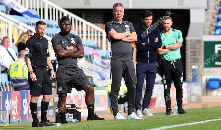 Peterborough United Manager Darren Ferguson watches on alongside Rochdale manager Brian Barry-Murphy