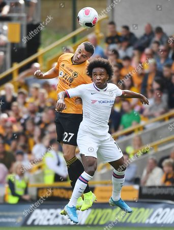 Chelsea's Willian (R) vies for the ball with Wolves' Romain Saiss (L) during an English Premier League soccer match at Molineux in Wolverhampton,  Britain, 14 September 2019.