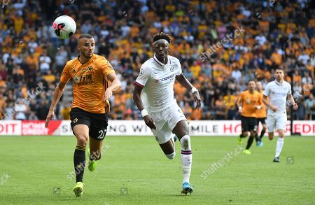 Chelsea's Tammy Abraham (R) vies for the ball with Wolves' Romain Saiss (L) during an English Premier League soccer match at Molineux in Wolverhampton,  Britain, 14 September 2019.