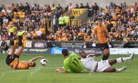 Chelsea's Michy Batshuayi (R) vies for the ball with Wolves' Romain Saiass (L)  and Wolves keeper Rui Patricio during an English Premier League soccer match at Molineux in Wolverhampton,  Britain, 14 September 2019.