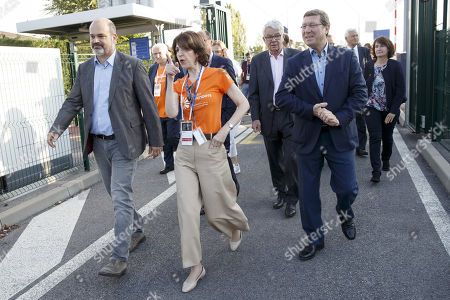 Director General of the European Organization for Nuclear Research (CERN) Fabiola Gianotti, (C), between Administrative Councillor of the City of Geneva Sami Kanaan (L) and Councillor of the Geneva State Mauro Poggia (R) arrives on CERN's site, during the CERN Opens Days, at the European Particle Physics laboratory (CERN), in Meyrin near Geneva, Switzerland, 14 September 2019.