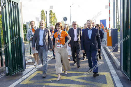 Director General of the European Organization for Nuclear Research (CERN) Fabiola Gianotti, (2-L), between Administrative Councillor of the City of Geneva Sami Kanaan (L) and Councillor of the Geneva State Mauro Poggia (R) arrives on CERN's site, during the CERN Opens Days, at the European Particle Physics laboratory (CERN), in Meyrin near Geneva, Switzerland, 14 September 2019.