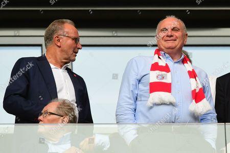 Munich president Uli Hoeness (R) and Munich CEO Karl-Heinz Rummenigge attend the German Bundesliga soccer match between RB Leipzig and FC Bayern Munich in Leipzig, Germany, 14 September 2019.
