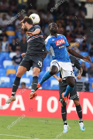 Sampdoria's defender Bartosz Bereszynski (L) and Napoli's defender Kalidou Koulibaly in action during the Italian Serie A soccer match between SSC Napoli and UC Sampdoria at the San Paolo stadium in Naples, southern Italy,  14 September 2019.