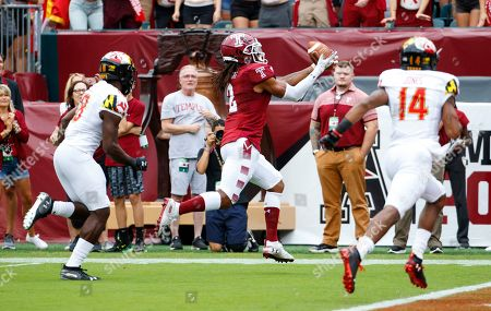 Stock Photo of Temple wide receiver Isaiah Wright (2) makes a reception for a touchdown as Maryland defensive backs Jordan Mosley (18) and Deon Jones (14) chase during the first half of an NCAA college football, in Philadelphia