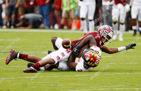 Stock Picture of Temple cornerback Christian Braswell, top, breaks up a pass intended for Maryland wide receiver Darryl Jones (21) during the first half of an NCAA college football, in Philadelphia