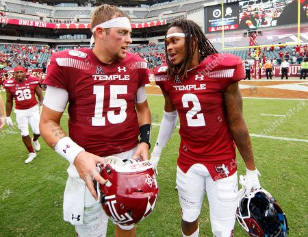 Temple quarterback Anthony Russo (15) and wide receiver Isaiah Wright (2) chat after an NCAA college football against Maryland, in Philadelphia. Temple won 20-17