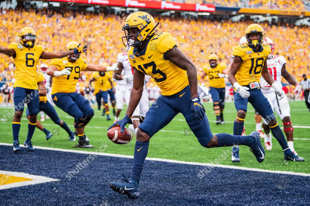 West Virginia Mountaineers wide receiver Sam James (13) scores a touchdown during the NCAA college football game between the North Carolina State Wolfpack and the West Virginia Mountaineers on at Milan Puskar Stadium in Morgantown, West Virginia