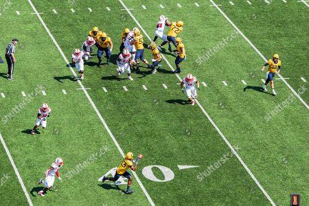 West Virginia Mountaineers quarterback Austin Kendall (12) throws to West Virginia Mountaineers wide receiver Sam James (13) during the NCAA college football game between the North Carolina State Wolfpack and the West Virginia Mountaineers on at Milan Puskar Stadium in Morgantown, West Virginia