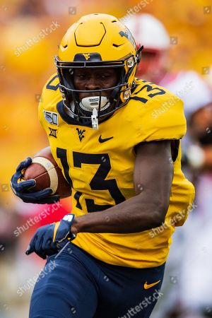West Virginia Mountaineers wide receiver Sam James (13) during the NCAA college football game between the North Carolina State Wolfpack and the West Virginia Mountaineers on at Milan Puskar Stadium in Morgantown, West Virginia