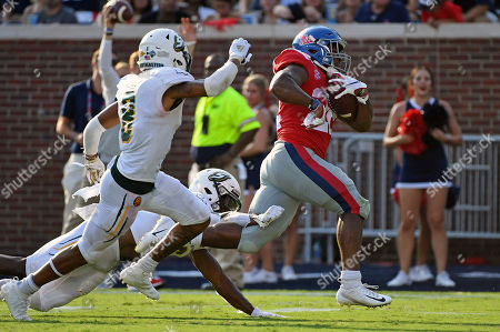 Mississippi running back Scottie Phillips (22) runs past Southeastern Louisiana defensive backs Dejion Lynch (6) and Donniel Ward-Magee (8) for a 27-yard touchdown during the first half of an NCAA college football game in Oxford, Miss., . Mississippi won 40-29