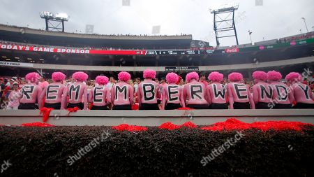 "Georgia fans observe a moment of silence in horror of Wendy Anderson, wife of Arkansas State head coach Blake Anderson before an NCAA college football game, in Athens, Ga. Fans were encouraged to ""pink out"" the stadium for Wendy Anderson who died from breast cancer in August"