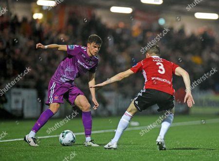 Derry City vs Dundalk. Dundalks Sean Gannon and Ciaran Coll of Derry